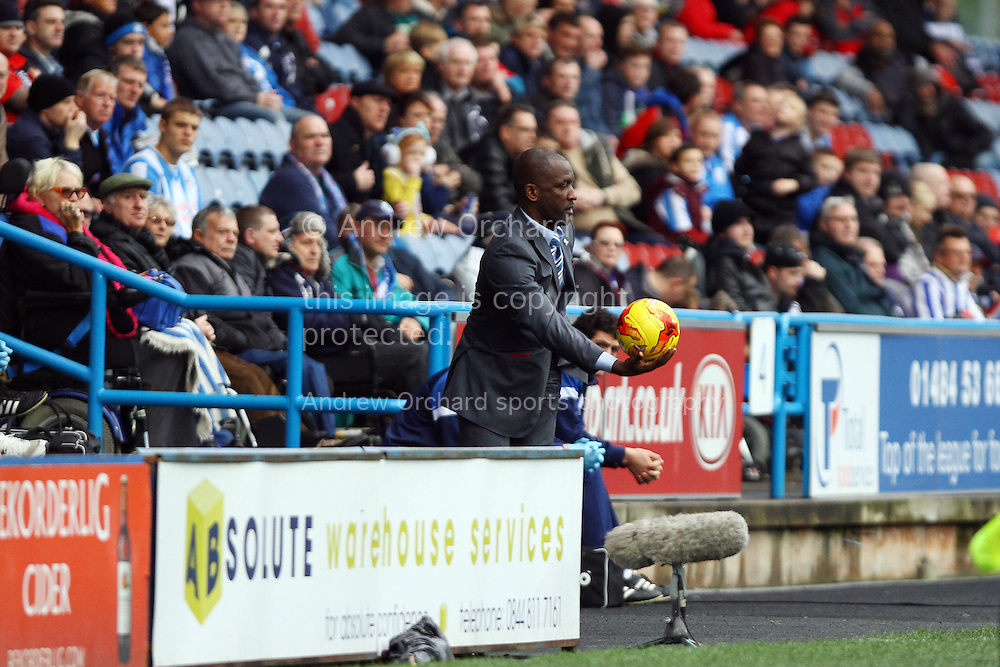Huddersfield Town Manager Chris Powell gives the ball back. Skybet football league championship match, Huddersfield Town v Sheffield Wednesday at the John Smith's stadium in Huddersfield, Yorkshire on Saturday 22nd November 2014.<br /> pic by Chris Stading, Andrew Orchard sports photography.