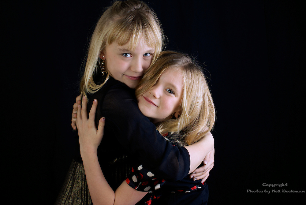 A portrait of two sisters.