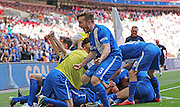 Glossop Matthew Russell celebrates the opening goal during the FA Vase Final between Glossop North End and North Shields at Wembley Stadium, London, England on 9 May 2015. Photo by Phil Duncan.