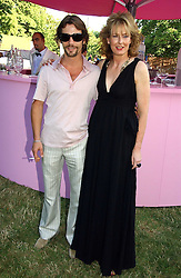 JAY KAY and JULIA PEYTON-JONES at the Serpentine Gallery Summer party sponsored by Yves Saint Laurent held at the Serpentine Gallery, Kensington Gardens, London W2 on 11th July 2006.<br /><br />NON EXCLUSIVE - WORLD RIGHTS