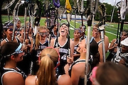 Kayla Bravo (middle), along with the Old Bridge lacrosse team, huddle together for a group cheer prior the Greater Middlesex Conference championship game against North Brunswick held at North Brunswick Township High School on May 11, 2015.