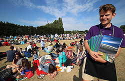 A programme seller at the start of day three of the Wimbledon Championships at the All England Lawn Tennis and Croquet Club, Wimbledon.