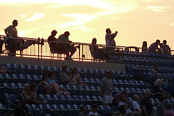 Fans at the top of the bleachers at dusk. Furthur Band at McCoy Stadium, Pawtucket RI on 5 July 2012