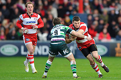 Gloucester Winger (#11) Shane Monahan is tackled by London Irish Scrum-Half (#9) Darren Allinson during the first half of the match - Photo mandatory by-line: Rogan Thomson/JMP - Tel: Mobile: 07966 386802 15/12/2012 - SPORT - RUGBY - Kingsholm Stadium - Gloucester. Gloucester Rugby v London Irish - Amlin Challenge Cup Round 4.