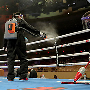 HOLLYWOOD, FL - APRIL 17:  Covid 19 clean up crews sanitize the ring between fights at Seminole Hard Rock Hotel & Casino on April 17, 2021 in Hollywood, Florida. (Photo by Alex Menendez/Getty Images) *** Local Caption ***