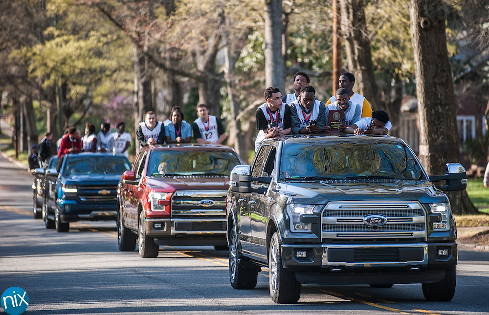 The NCHSAA 3A State Champion Jay M. Robinson basketball team is honored by the City of Concord with a parade down Union Street Monday afternoon.