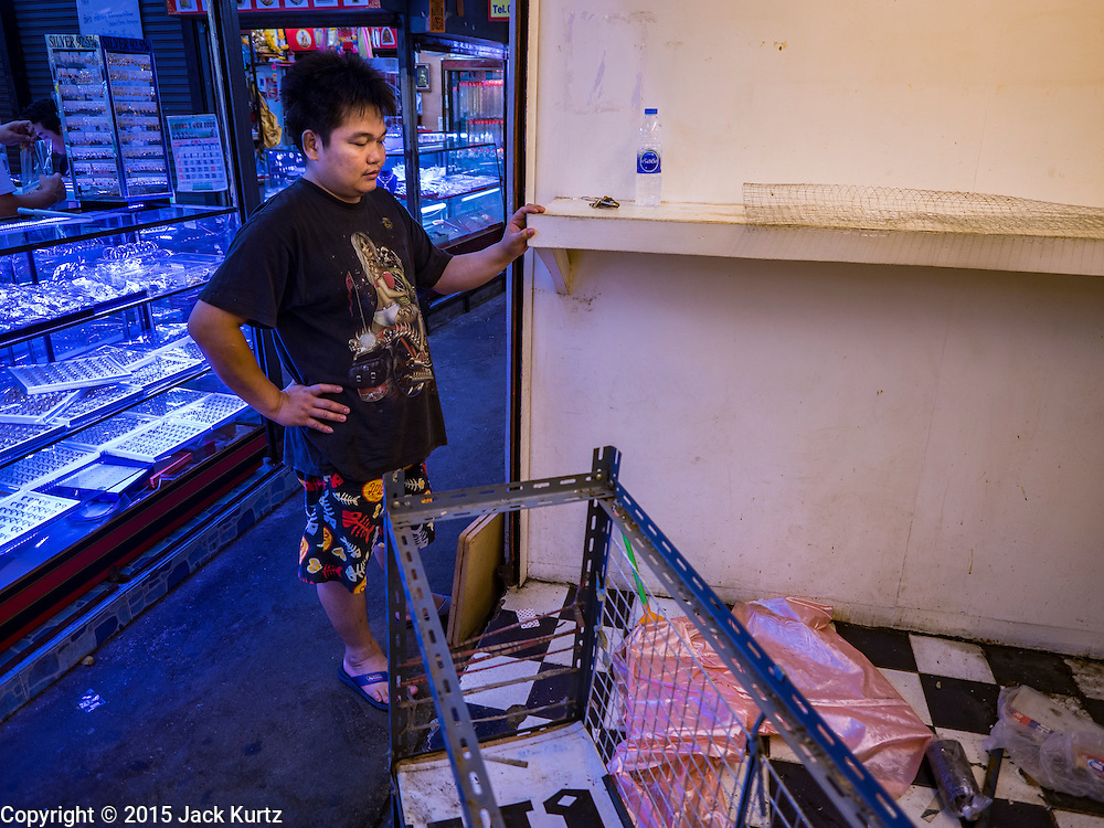 11 OCTOBER 2015 - BANGKOK, THAILAND:  An alley in the Saphan Han market. Many shops in the market are already closed. Street vendors and illegal market vendors in the Saphan Han and Saphan Lek area will be removed in the next two weeks as a part of an urban renewal project coordinated by the Bangkok Metropolitan Administration. About 500 vendors along Damrongsathit Bridge, popularly known as Saphan Lek, have until Monday, October 11,  to relocate. Vendors who don't move will be evicted. Saphan Lek is one of several markets and street vending areas being closed in Bangkok this year. The market is known for toy and replica guns, bootleg and pirated DVDs and CDs and electronic toys.   PHOTO BY JACK KURTZ OCTOBER 2015 - BANGKOK, THAILAND:  A man who had a coffee stand in the Saphan Han market looks at what's left of his shop after he closed it ahead of the deadline for shops to be out of Saphan Han. Many shops in the Saphan Han and Saphan Lek markets are already closed. Street vendors and illegal market vendors in the Saphan Lek area will be removed in the next two weeks as a part of an urban renewal project coordinated by the Bangkok Metropolitan Administration. About 500 vendors along Damrongsathit Bridge, popularly known as Saphan Lek, have until Monday, October 11,  to relocate. Vendors who don't move will be evicted. Saphan Lek is one of several markets and street vending areas being closed in Bangkok this year. The market is known for toy and replica guns, bootleg and pirated DVDs and CDs and electronic toys.   PHOTO BY JACK KURTZ