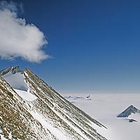 ANTARCTICA. Nunataks south of Vinson Massif in Ellsworth Mountains. Vast polar plateau in background.