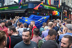 Portland Place, London, June 25th 2016. Thousands of LGBT people and their supporters gather for Pride in London, a colourful celebration of the hard-won rights of lesbian, gay, bisexual and transgender  people. PICTURED: With loud cheers from the crowd, an EU flag is carried through Soho