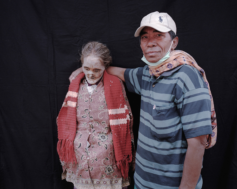 Martin with his wife, Yohana Liding, who passed away in 1997.<br /> <br /> Ma'nene is a tradition that takes place in August after harvest where the bodies of the dead loved ones are exhumed to be cleaned, groomed and dressed. For most, it's a bittersweet moment, a chance to reunite and physically see and touch and reconnect with loved ones who had passed on.