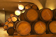 "Wooden barrels with aging wine in the cellar of Guigal in Ampuis. Barrels stored ""bond a cote"" with the bung hole to the side.  Domaine E Guigal, Ampuis, Cote Rotie, Rhone, France, Europe"