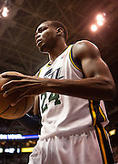 Jazz forward Paul Millsap (24) gets ready to inbound the ball during the first half of the NBA basketball game between the Utah Jazz and the San Antonio Spurs at Energy Solutions Arena, Wednesday, Dec. 12, 2012.