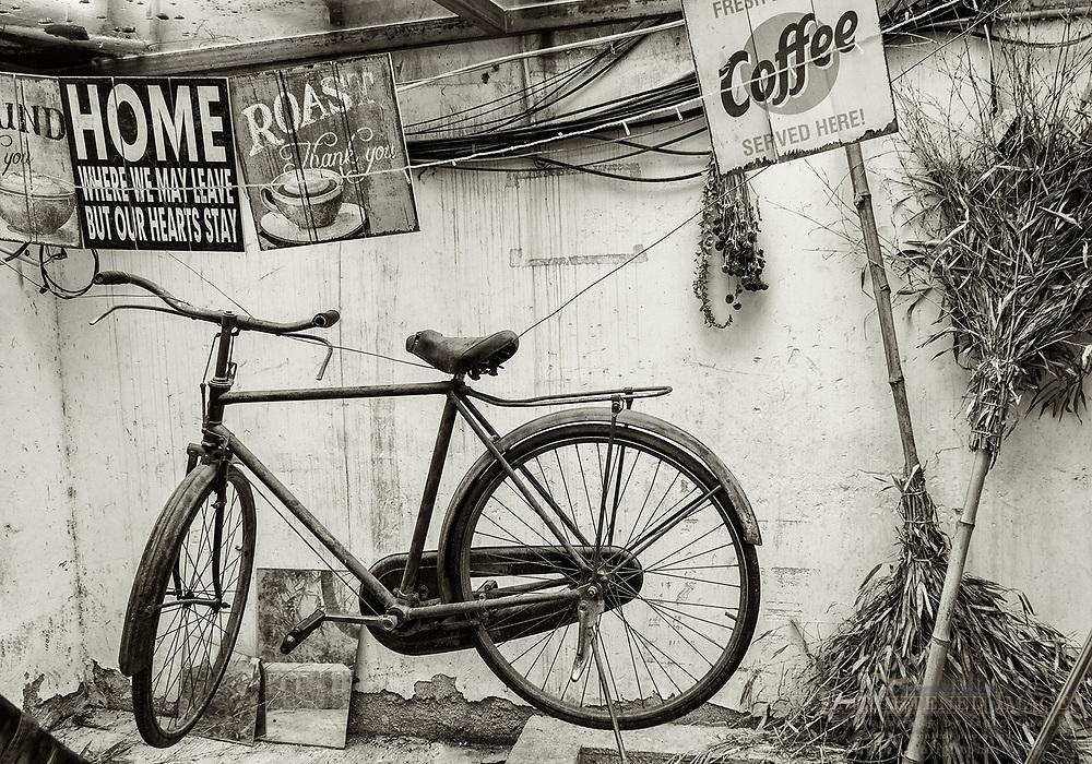 Bike and english coffee signs in alley off of Pingjiang Road, Suzhou, jiangsu Province, China