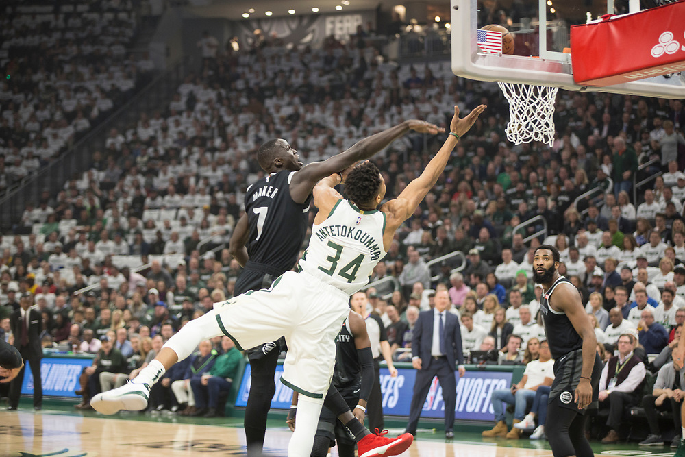 Giannis Antetokounmpo makes a move past Thon Maker during the Milwaukee Bucks' playoff opener against the Detroit Pistons on April 14, 2019.