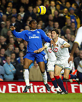 Fotball<br /> England 2004/2005<br /> Foto: SBI/Digitalsport<br /> NORWAY ONLY<br /> 22.01.2005<br /> <br /> Chelsea v Portsmouth<br /> Barclays Premiership. 22/01/2005<br /> Didier Drogba goes up for this one with Dejan Stefanovic of Portsmouth