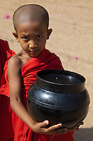 Nearly all Burmese boys become novice monks usually between the ages of 10 and 20.  All things that may be possessed by novice monks must be offered by the community.  The only things allowed to keep are robes, a cup, an umbrella and an alms bowl.