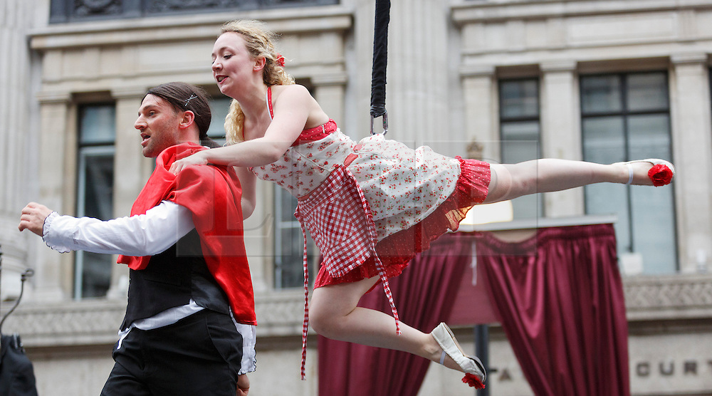 © Licensed to London News Pictures. 02/09/2012. London, England. Pictured: Wired Aerial Theatre (UK) - Rosa's Bar, aerial tango performance. Piccadilly Circus Circus with performers just for one day, in celebration of the London 2012 Games. Central London around Piccadilly Circus has been transformed into a Circus arena with acrobats and performers. Part of the London 2012 Festival. Photo credit: Bettina Strenske/LNP