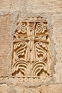 Pictures & images of Nikortsminda ( Nicortsminda ) St Nicholas Georgian Orthodox Cathedral exterior and its Georgian relief sculpture stonework cross decorations, 11th century, Nikortsminda, Racha region of Georgia (country). A UNESCO World Heritage Tentative Site. .<br /> <br /> Visit our MEDIEVAL PHOTO COLLECTIONS for more   photos  to download or buy as prints https://funkystock.photoshelter.com/gallery-collection/Medieval-Middle-Ages-Historic-Places-Arcaeological-Sites-Pictures-Images-of/C0000B5ZA54_WD0s<br /> <br /> Visit our REPUBLIC of GEORGIA HISTORIC PLACES PHOTO COLLECTIONS for more photos to browse, download or buy as wall art prints https://funkystock.photoshelter.com/gallery-collection/Pictures-Images-of-Georgia-Country-Historic-Landmark-Places-Museum-Antiquities/C0000c1oD9eVkh9c