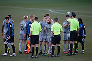 Players and officials bump fists at full time during the EFL Sky Bet League 1 match between Rochdale and Burton Albion at the Crown Oil Arena, Rochdale, England on 27 February 2021.