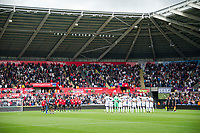 Football - 2017 / 2018 Premier League - Swansea City vs. Manchester United<br /> <br /> Teams line up for minutes clap for a former Swansea official —<br /> , at Liberty Stadium.<br /> <br /> COLORSPORT/WINSTON BYNORTH