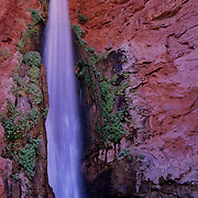 Stunning waterfall beside the Colorado River at the bottom of the Grand Canyon, Grand Canyon National Park, Arizona.