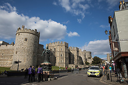 Windsor, UK. 16th April, 2021. Community wardens from the Royal Borough of Windsor and Maidenhead and police officers from Thames Valley Police maintain security outside Windsor Castle on the eve of the funeral of the Duke of Edinburgh.