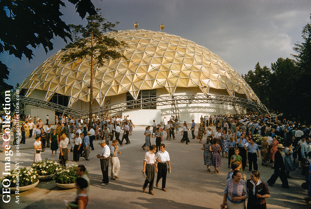 The Kaiser Geodesic Dome, at the American National Exhibition, Moscow 1959. <br /> Tourists visiting the grounds at a geodesic dome.