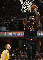 April 29, 2018 - Cleveland, OH, USA - Cleveland Cavaliers forward LeBron James dunks over Indiana Pacers forward Bojan Bogdanovic in the third quarter of Game 7 of the Eastern Conference First Round series on Sunday, April 29, 2018 at Quicken Loans Arena in Cleveland, Ohio. The Cavs won the game, 105-101. (Credit Image: © Leah Klafczynski/TNS via ZUMA Wire)