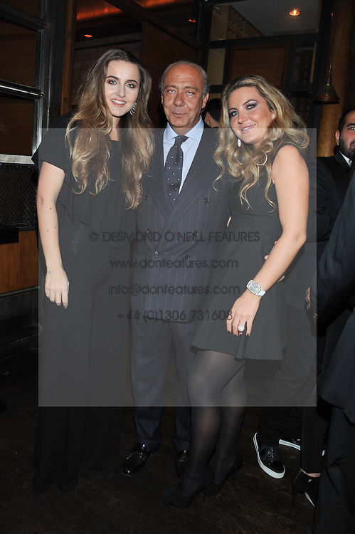 FAWAZ GRUOSI and his daughters, left VIOLETTA GRUOSI and right ALLEGRA GRUOSI at a dinner hosted by de Grisogono at 17 Berkeley Street, London on 12th November 2012.