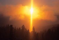 A sun dog glows at sunset above Teton valley, Idaho.