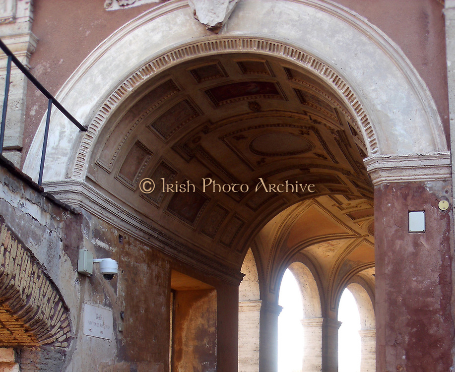 Decorative detail from the area surrounding Castel Sant'Angelo and the Ponte Sant'Angelo in Rome, Italy. Many decorative sculptural and architectural details adorn the length of the bridge, as well as the area surrounding it and the Castel Sant'Angelo. This image shows an archway.