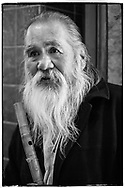 Fuji-Neopan-1600 Portrait of an elder Native Indian, member of the silver tsunami, the baby boom generation, now a senior citizen and flute player street musician in Santa Fe, New Mexico.