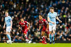 John Stones of Manchester City is challenged by Bobby Reid of Bristol City - Rogan/JMP - 09/01/2018 - Etihad Stadium - Manchester, England - Manchester City v Bristol City - Carabao Cup Semi Final First Leg.