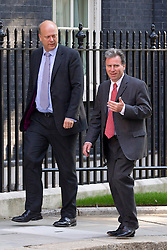 "© Licensed to London News Pictures. 29/08/2013. London, UK. Minister of State at the Cabinet Office Oliver Letwin (R) arrives with Justice Secretary Chris Grayling for a meeting of the British cabinet on Downing Street in London today (29/08/2013) as a recalled British Parliament prepares to debate the possibility of ""direct"" military action over recent reports an alleged chemical weapons attack in Syria. Photo credit: Matt Cetti-Roberts/LNP"
