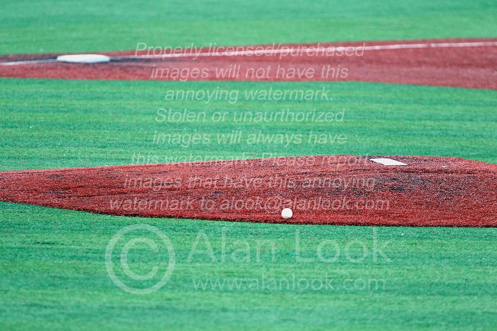06 July 2013:  Game baseball lies one the mound apron awaiting play