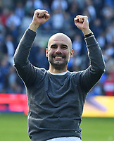 BRIGHTON, ENGLAND - MAY 12:  Manchester City manager celebrates winning the Premier League title at full time with his team mates during the Premier League match between Brighton & Hove Albion and Manchester City at American Express Community Stadium on May 12, 2019 in Brighton, United Kingdom. (MB Media)