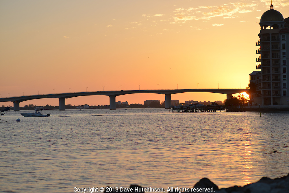John Ringling Causeway Bridge and Golden Gate Point silhouetted against a golden sunset view from Bayfront Park, downtown Sarasota, Florida, recently named a great waterfront to visit by USA Today