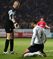 Photo:  Frances Leader, Digitalsport<br /> Charlton Athletic v Tottenham Hotspur. Barclays Premiership. <br /> The Valley<br /> 16/05/2005<br />  Spurs Frederic Kanoute's is offered a helping hand up by Charlton's goalie Dean Kiely