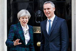 © Licensed to London News Pictures. 10/05/2017. London, UK. British Prime Minister THERESA MAY greets Nato Secretary General JENS STOLTENBERG on the steps of 10 Downing Street in London on Wednesday, 10 May 2017. Photo credit: Tolga Akmen/LNP