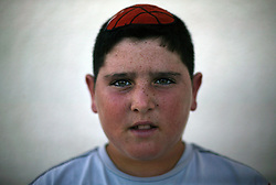 "Yair Hazout, 12, resident of the Gush Katif settlements is seen in Gaza, Palestinian Territories, Nov. 11, 2004. When asked his thoughts about leaving the settlements Hazout responded, ""It is very bad for Sharon to want to separate us. I have friends here and a home."" Israel's parliament recently supported compensation payments for Jewish settlers leaving the Gaza Strip, in a vital vote for Prime Minister Ariel Sharon's plan to evacuate the occupied territory."
