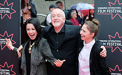 """Edinburgh International Film Festival, Sunday 26th June 2016<br /> <br /> Stars turn up on the closing night gala red carpet for the World Premiere of """"Whisky Galore!""""  at the Edinburgh International Film Festival 2016<br /> <br /> Composer Patrick Doyle with his daughters Abigail (dark hair) and Nuala (blonde)<br /> <br /> (c) Alex Todd 
