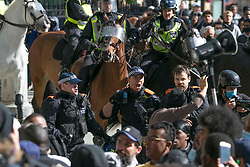 © Licensed to London News Pictures. 13/06/2020. London. Police confront demonstrators during clashes between BLM protesters and far-right groups in Trafalgar Square in central London. British police have imposed strict restrictions on groups planning to protest in London Saturday in a bid to avoid violent clashes between protesters from the Black Lives Matter movement, as well as far-right groups. Photo credit: Marcin Nowak/LNP