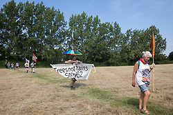 Harefield, UK. 26 June, 2020. Activists from HS2 Rebellion and Extinction Rebellion UK take part in a 'Rebel Trail' hike along the route of the HS2 high-speed rail link from Birmingham to London. The activists, who departed from Birmingham on 20th June and will arrive outside Parliament in London on 27th June, are protesting against the environmental impact of the high-speed rail link and questioning the viability of the £100bn+ project.