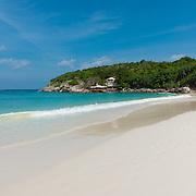 Perfect shore line of white sand on Raya island, near Phuket, Thailand