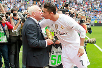 Real Madrid's Field Delegate Agustin Herrerin gives the Golden Shoe award to Cristiano Ronaldo during La Liga match.  October 17,2015. (ALTERPHOTOS/Acero)