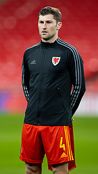 LONDON, ENGLAND - Thursday, October 8, 2020: Wales' Ben Davies lines-up for the national anthem before the International Friendly match between England and Wales at Wembley Stadium. The game was played behind closed doors due to the UK Government's social distancing laws prohibiting supporters from attending events inside stadiums as a result of the Coronavirus Pandemic. England won 3-0. (Pic by David Rawcliffe/Propaganda)