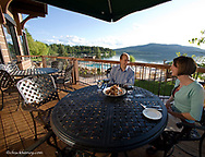Dining on the deck at The Lodge at Whitefish Lake Resort model released