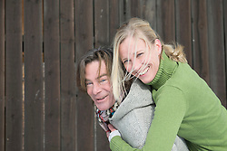 Man giving piggyback ride to woman, smiling, Bavaria, Germany