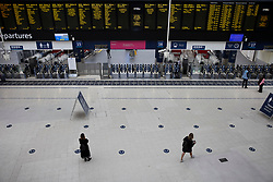© Licensed to London News Pictures. 07/09/2020. London, UK. Passengers wait for trains at Waterloo Station. Train capacity is supposed to reach 90% today as holidays come to an end and schools return. Photo credit: Peter Macdiarmid/LNP