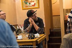BMW Motorrad Creative Director Ola Stenegard at lunch during a Tokyo shop tour after Mooneyes. Japan. December 8, 2015.  Photography ©2015 Michael Lichter.